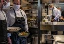 In a German Restaurant, the Sommelier Lifts His Mask to Smell the Wine